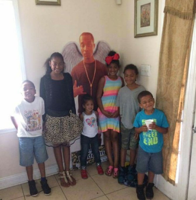 My nieces and nephews with a life size photo of their uncle